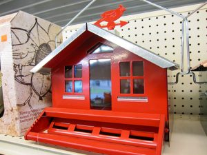 red bird house on shelf at pro ag farmers