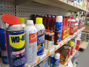 Stocked shelves with various oils and lubricants